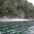 Steaming_hot_water_layer_near_Hot_Water_Beach_on_Lake_Tarawera